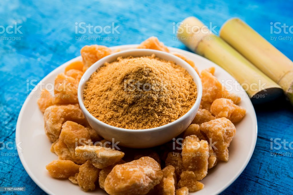 Organic Gur or Jggery Powder Organic Gur or Jggery Powder is unrefined sugar obtained from concentrated sugarcane juice. served in a bowl. selective focus Brown Stock Photo