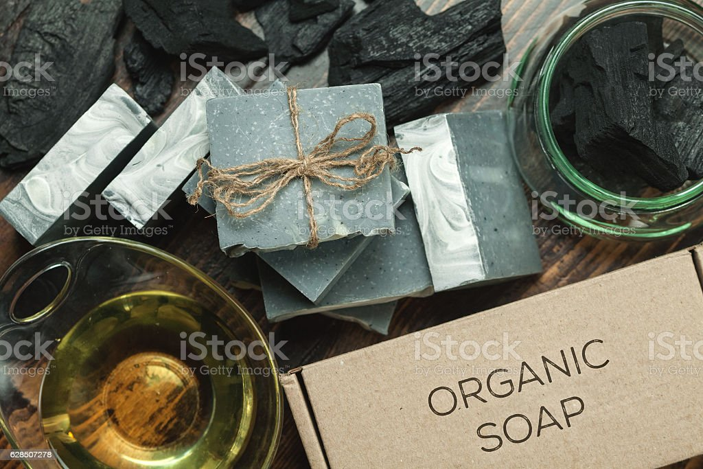 Organic handmade soap with natural charcoal stock photo