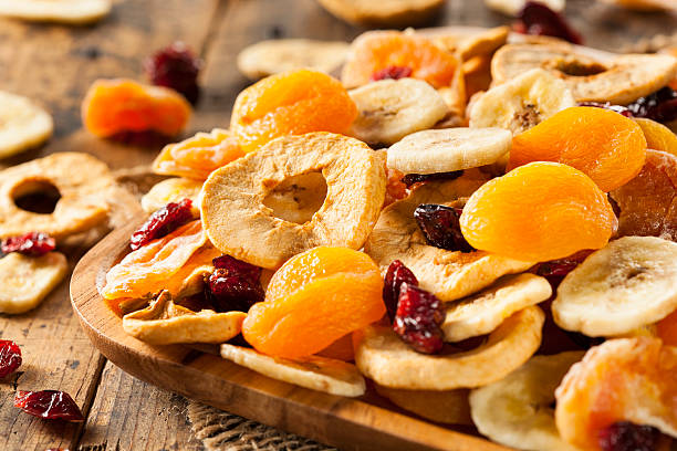organic healthy assorted dried fruit - dried fruit stock photos and pictures