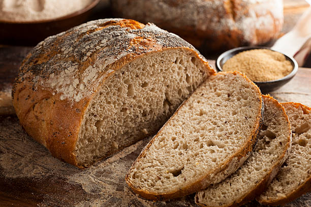 antigua flor de pan casero orgánicos - pan multicereales fotografías e imágenes de stock