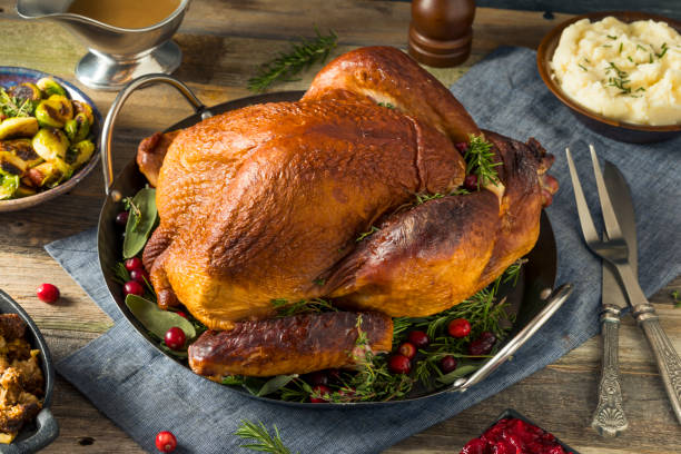 Organic Homemade Smoked Turkey Dinner for Thanksgiving Organic Homemade Smoked Turkey Dinner for Thanksgiving with Sides thyme photos stock pictures, royalty-free photos & images