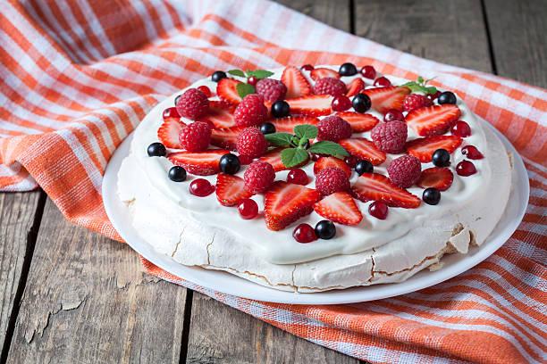 Organic homemade traditional meringue dessert sweet cake with whipper cream stock photo