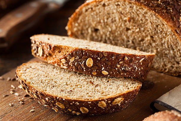 Organic Homemade Whole Wheat Bread Organic Homemade Whole Wheat Bread Ready to Eat bread stock pictures, royalty-free photos & images