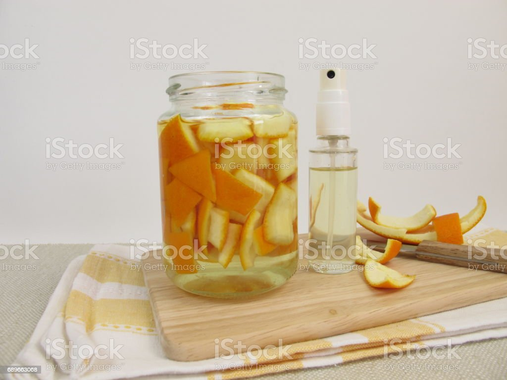 Organic household detergent with orange peel and vinegar in spray bottle stock photo