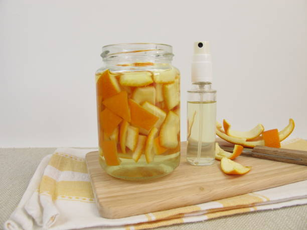Organic household detergent with orange peel and vinegar in spray bottle stock photo