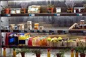 Assortment of organic juices on refrigerator shelfs
