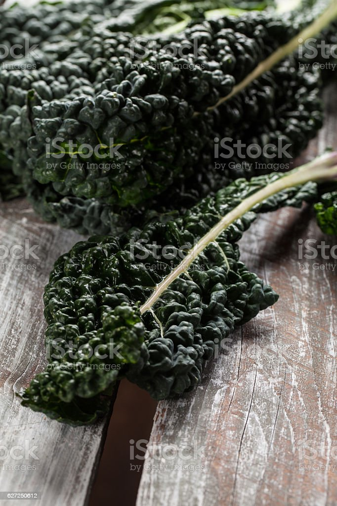 Organic Lacinato Kale weathered table stock photo