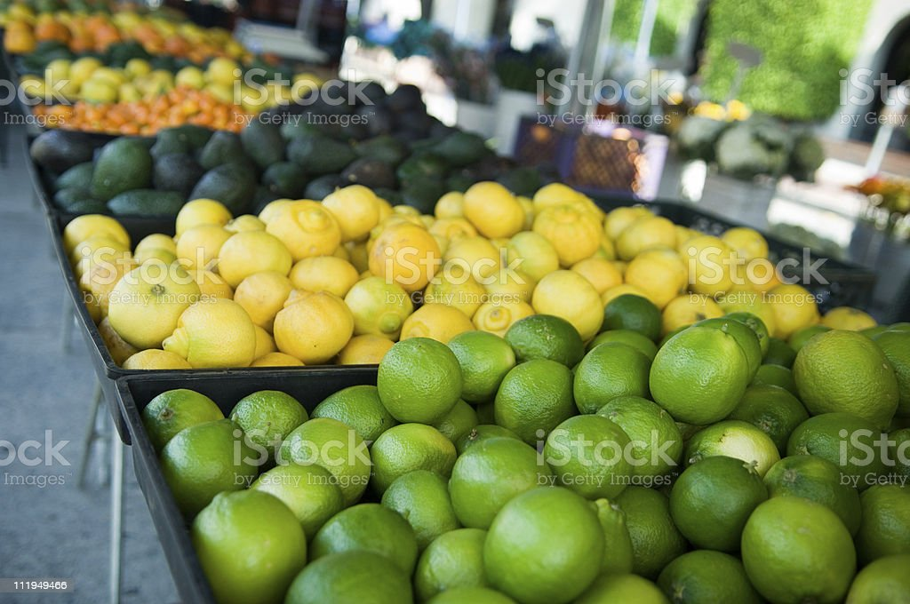 Organic Lemons Limes Avocados for Sale at Farmer's Market royalty-free stock photo