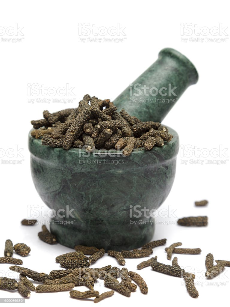 Organic Long pepper (Piper longum) on marble pestle stock photo