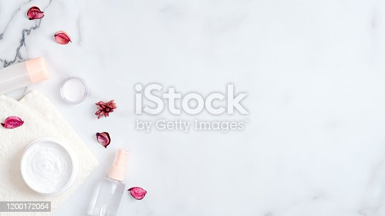 1128479585 istock photo SPA organic natural cosmetic products on marble background. Top view body and face moisturizer cream and lotion. Skin Care, beauty, SPA concept. 1200172054