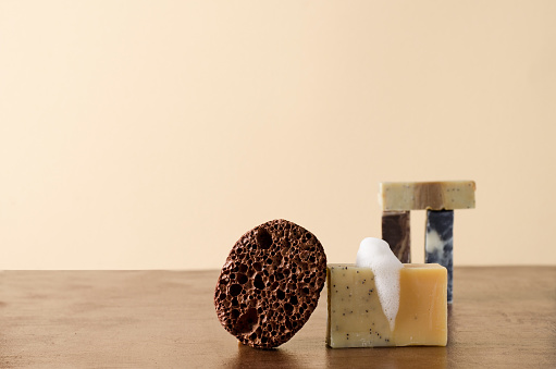 Organic natural soap and peeling stone on a beige background with copying space close-up