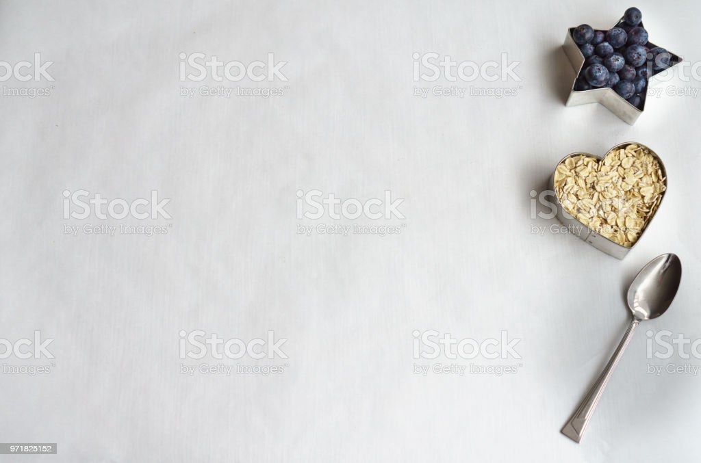 Organic Oats and Blueberries with Spoon stock photo