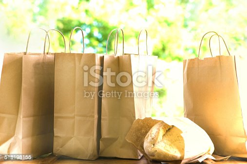 Organic bread and paper shopping bags in a row