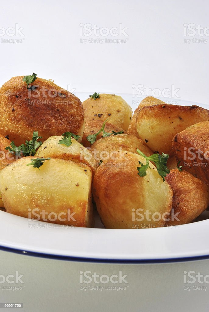organic parsley roasties in a white bowl royalty-free stock photo