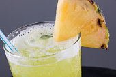 Organic pineapple cocktail juice with real slice of pineapple