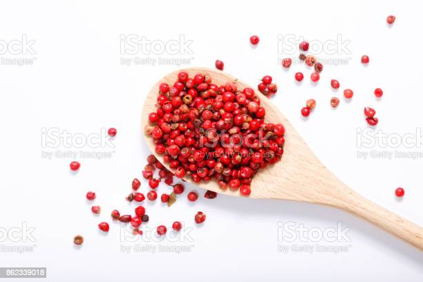 Organic pink peppercorn in wooden spoon on white background with copy picture id862339018?b=1&k=6&m=862339018&s=612x612&h=k xiy5lxqlpxrppdkshoassxdbspurnhdrjaz77bsme=
