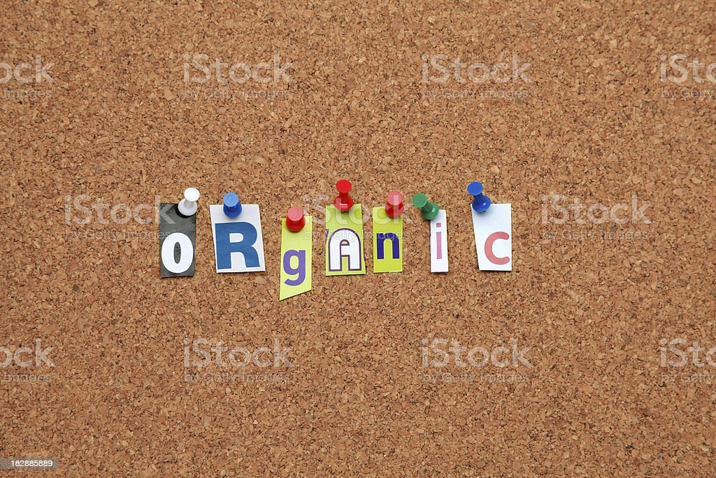Organic pinned on noticeboard royalty-free stock photo
