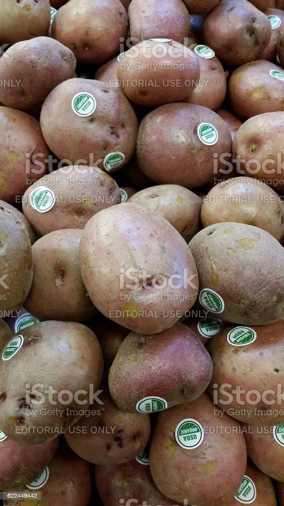 USDA organic potatos in a pile stock photo