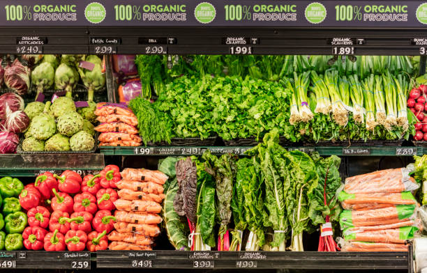 Organic produce in grocery store Organic vegetables in the produce aisle of a supermarket. produce aisle stock pictures, royalty-free photos & images