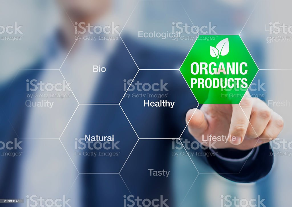 Organic products concept, businessman touching green button stock photo