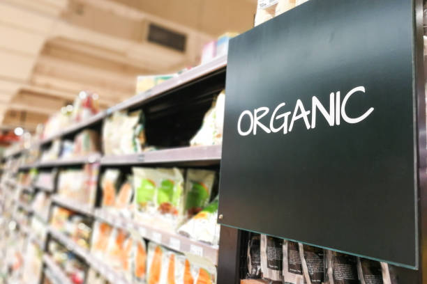 organic products grocery category aisle at supermarket - organic stock pictures, royalty-free photos & images