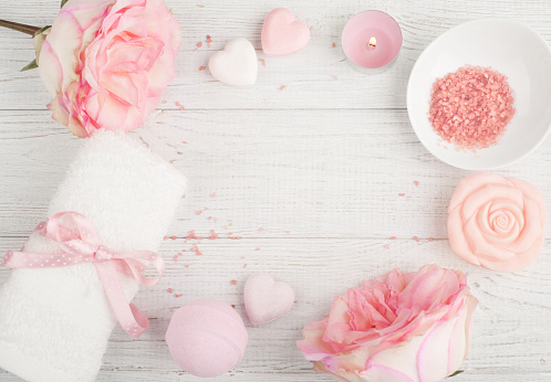 656780900 istock photo SPA organic products with roses, bath salt 924483760