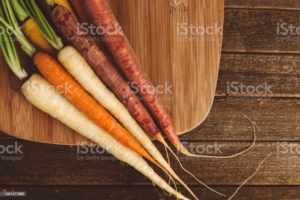 organic rainbow carrots stock photo