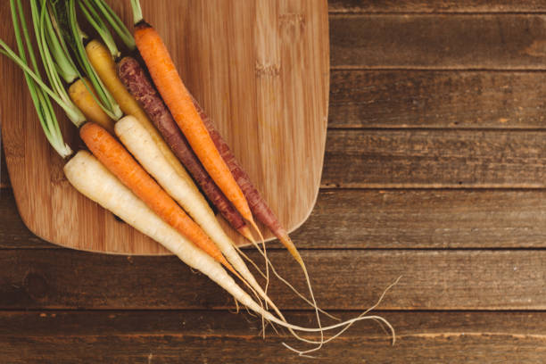 organic rainbow carrots stock photo