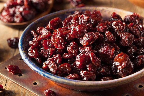 organic raw dry cherries - gedroogd voedsel stockfoto's en -beelden