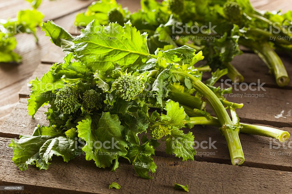 Organic Raw Green Broccoli Rabe Rapini stock photo