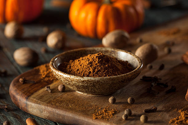 Organic Raw Pumpkin Spice Organic Raw Pumpkin Spice with Cinnamon Allspice Nutmeg and Ginger nutmeg stock pictures, royalty-free photos & images