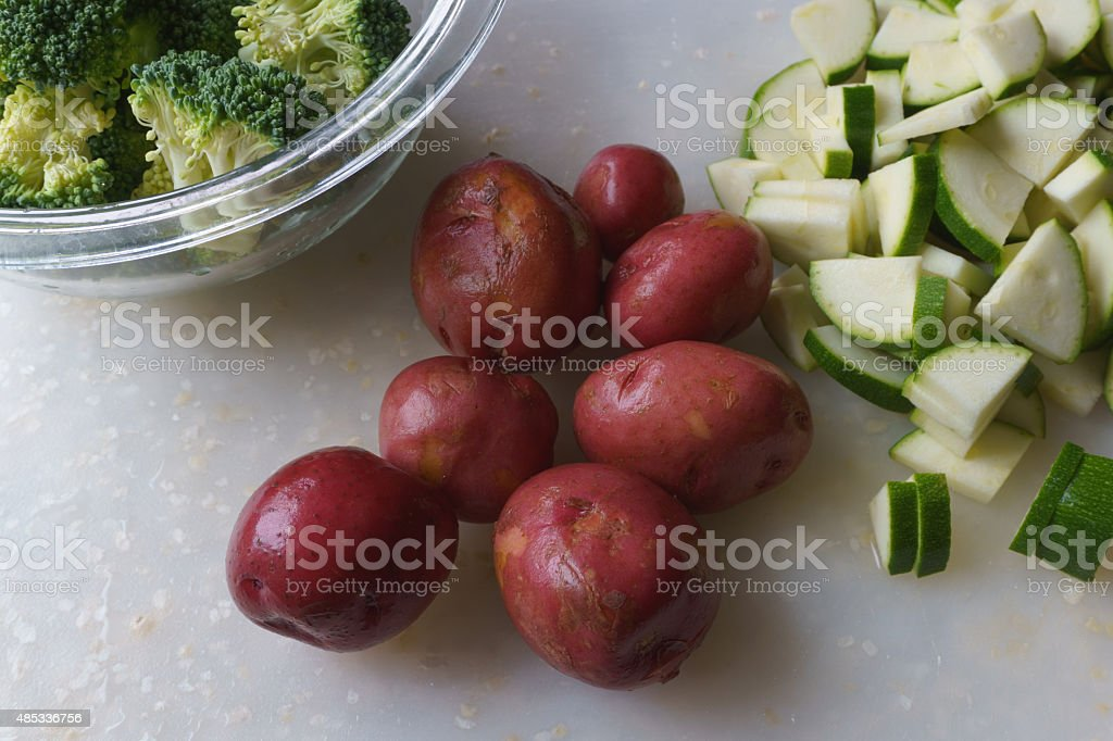 Organic Red Potatoes, Zucchini and Broccoli stock photo