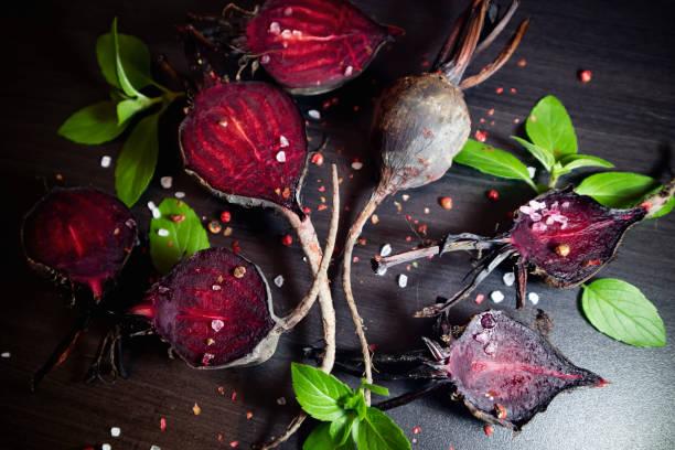 Organic roasted beetroots on dark background. stock photo