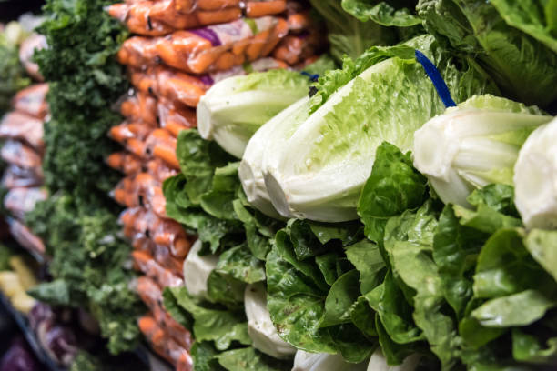 Organic Romaine lettuce for sale Organic Romaine lettuce for sale in a supermarket romaine lettuce stock pictures, royalty-free photos & images