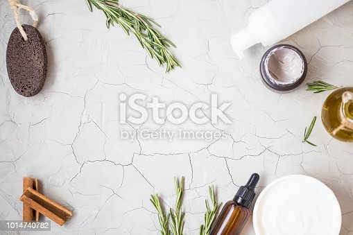 istock Organic skincare products flatlay with oil bottle, pumice, olive oil, tonic lotion , clay face mask and body butter on clean minimalist grey concrete background with copy space 1014740782