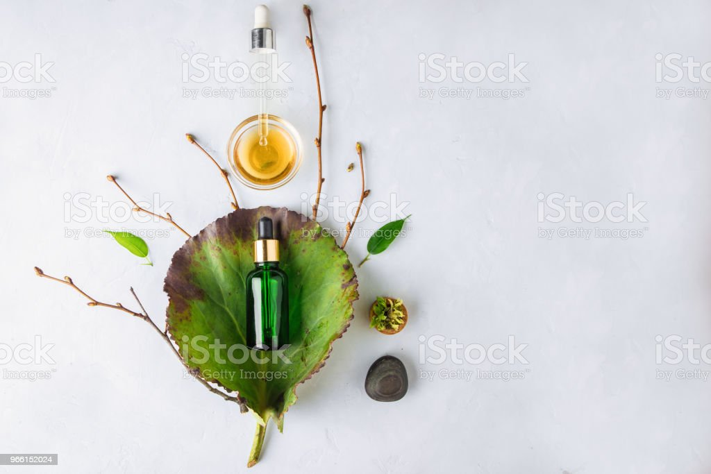 Organic Spa Cosmetic With Herbal Ingredients. Vegetable serum for skin with herbal extracts. glass bottle with a pipette - Royalty-free Anti Aging Stock Photo