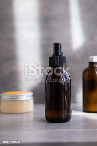 1167558793 istock photo Organic spa cosmetics in brown glass bottles 1001515500