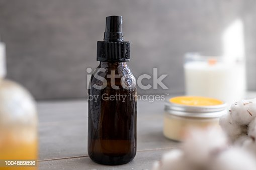 1167558793 istock photo Organic spa cosmetics in brown glass bottles 1004889896