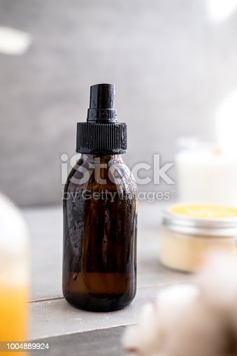 1167558793 istock photo Organic spa cosmetics in brown glass bottles 1004889924