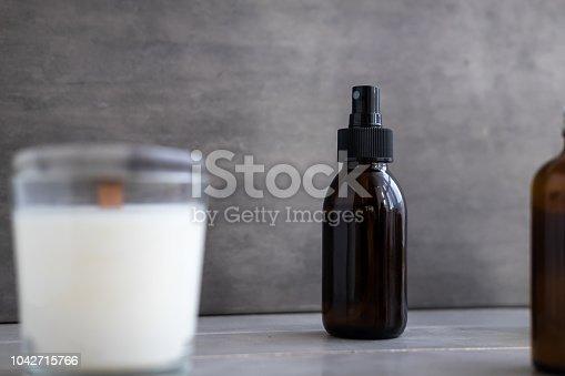 1042453716 istock photo Organic spa cosmetics in brown glass bottles 1042715766