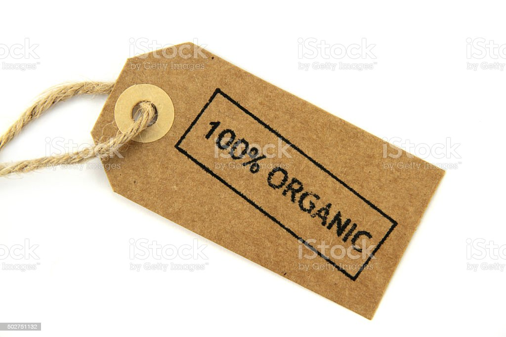 ' 100% Organic ' stamped  on a natural paper label stock photo