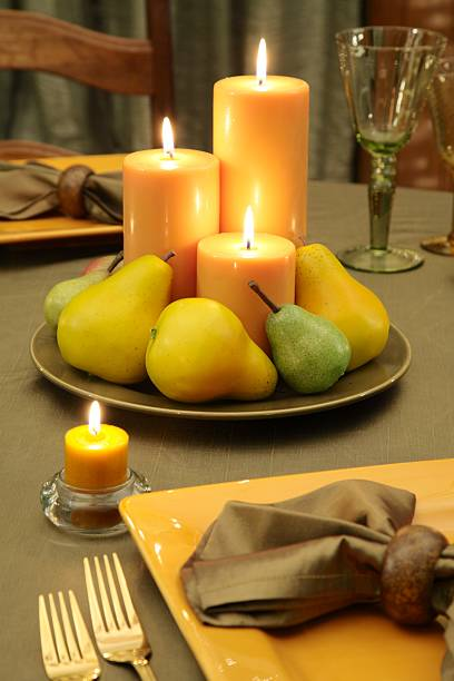 Organic table setting and Decoration with candles and fruit stock photo
