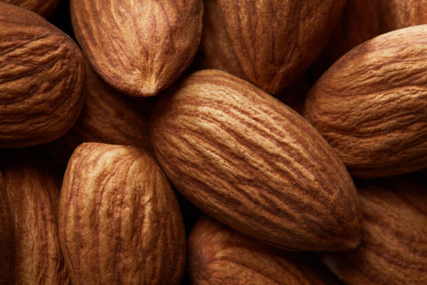 Organic texture of almonds. View from above stock photo