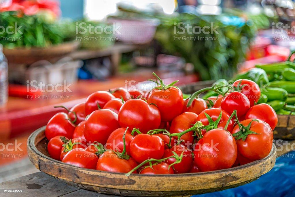 Organic Tomatoes in basket, market scene stock photo