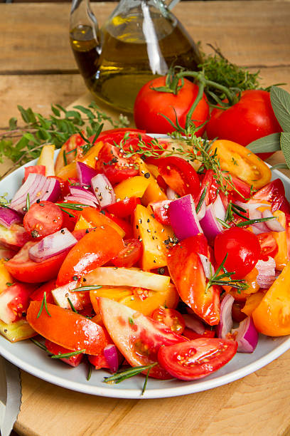 Organic Tomatoes Ready To roast In A Baking Dish stock photo