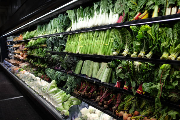 Organic vegetable aisle in grocery store Organic vegetable aisle in grocery store produce aisle stock pictures, royalty-free photos & images