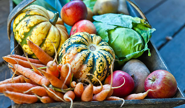 Organic Vegetables and Fruit in Wooden Basket stock photo