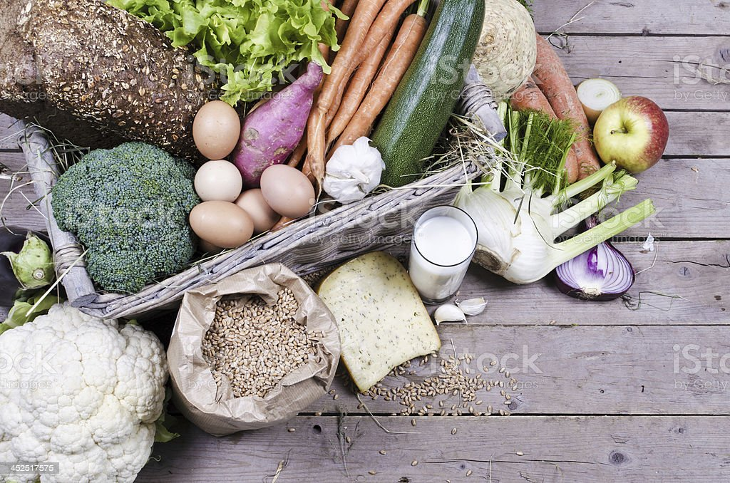 Organic vegetables, milk, eggs and cheese stock photo