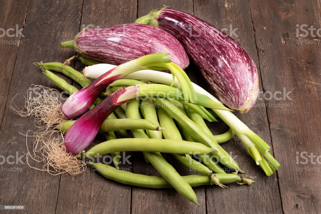 Organic vegetables of aubergine beans and shallots ripening royalty-free stock photo