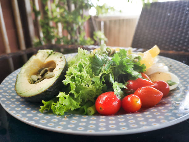 Organic vegetarian ketogenic diet raw food on plate stock photo